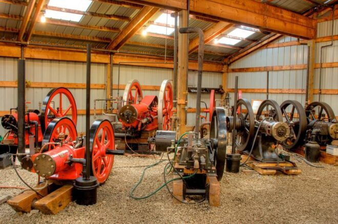 Interior of Coolspring Power Museum with many one-cylinder egines.
